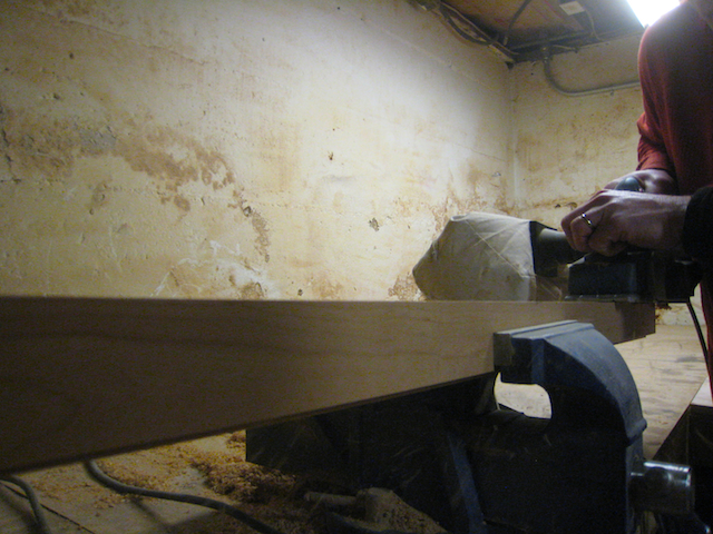 Planing out the blade marks from a piece of hard wood