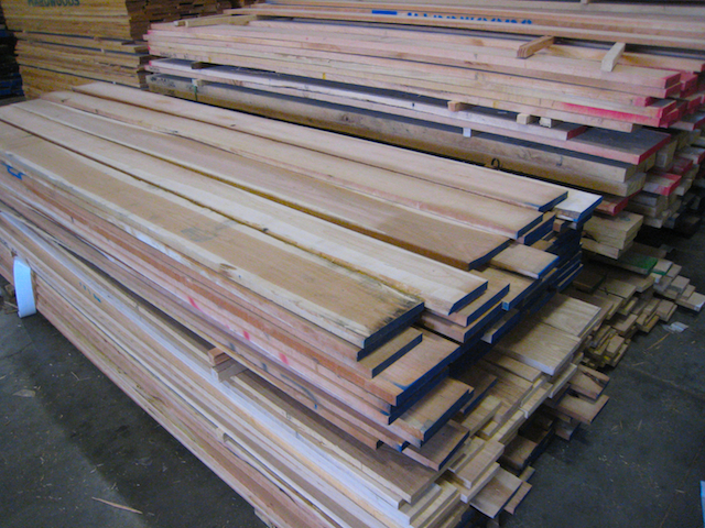 Piles of rough sawn Cherry at Hardwood Industries, in Bend, Oregon.