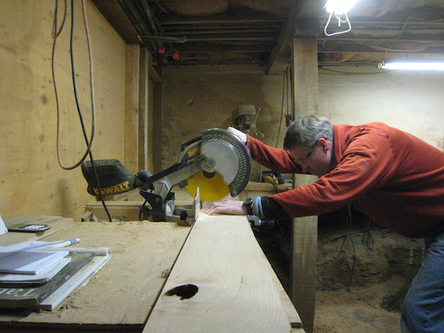 Cutting hardwood to length in my wood shop with my miter saw