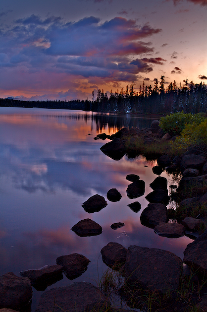 Big Lake reflects a beautiful sunset high in the Central Oregon Cascades