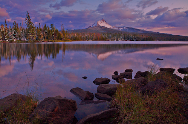 Mt. Washington and Big Lake's shore line illuminated by pastel skies high in the Central Oregon Cascades.