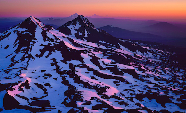 """Summit Sunrise"" Alpenglow illuminating the cascade crest extending from Middle Sister north to Mt. Rainier"