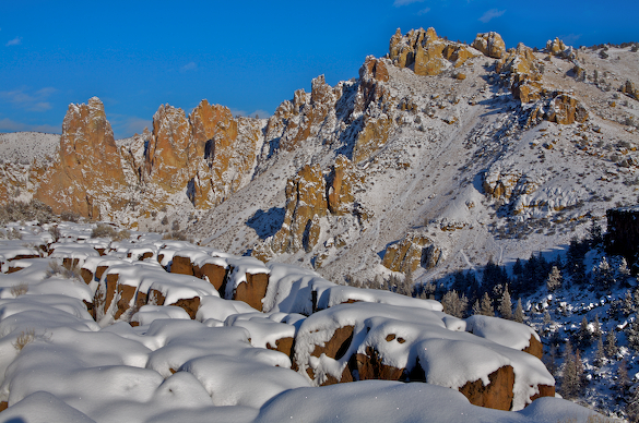 Smith Rock towers and snow covered basalt columns