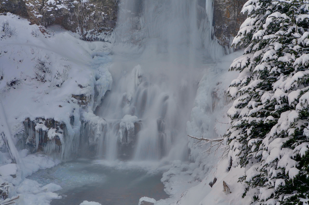 Icy formations beneath Tumalo Falls near Bend, Oregon.