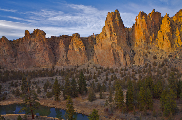 Golden evening light bathes the monument and the Crooked River at Smith Rock State Park