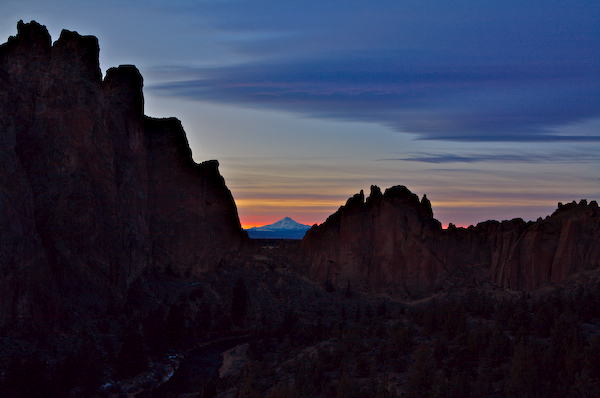 Mt. Jefferson framed above Smith Rock's asterisk pass at sunset with the morning glory wall to the right.