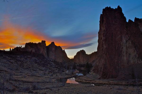 Sunset photo of Smith Rock State Park and the Crooked River below