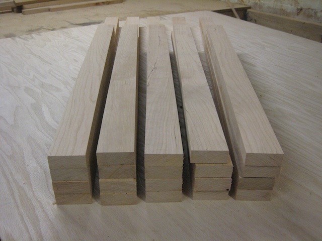 Unstained cherry wood cut to dimensions for picture frames.